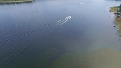 Seeley Lake-speed boat towing tuber