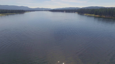 Seeley Lake with tuber racing by