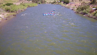 A groups of  rafters cool off throwing water on each other.