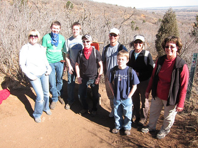 Still managing to smile - at least for the camera. L-R: Suzi, Chandler, Ian, Hunter, Randy, Tristan, Becky and Emily.