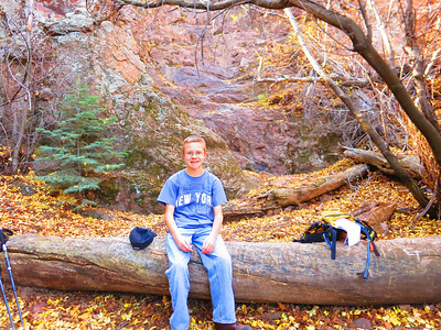 Sitting on the same log before the now ice-free and dry waterfall.