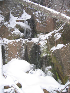 Same place frozen over in late winter - crampons needed for ascent.