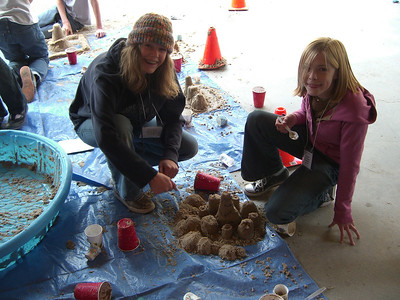 Kelsey and Emily demonstrating their sandcastle-building talents.