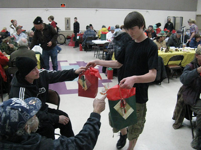 Handing out gift bags during the meal.