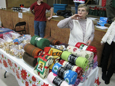 Lots of fleece blankets donated by parishioners to pass out.