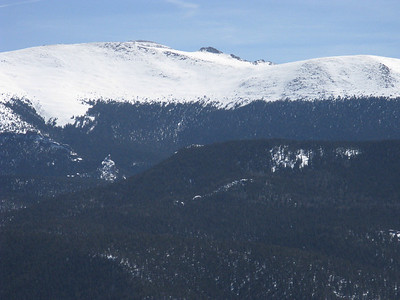 From this angle the summit is barely visible atop left hump.