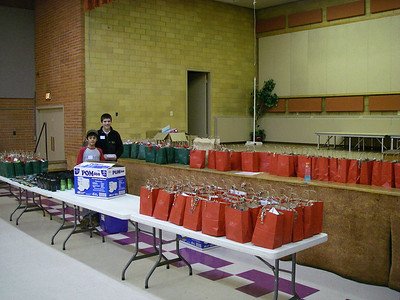 Setting up the give-away bags.  Red for women and green for men.