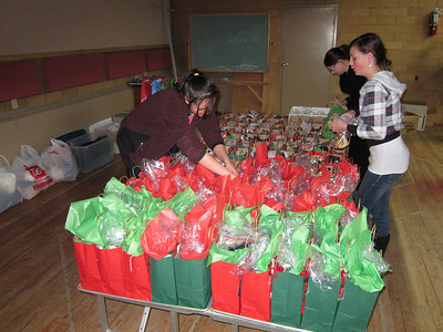 Staging our 135 assembled gift bags - a guy version, a gal version and a kid version. Those left over are being given to Northern Churches Care.