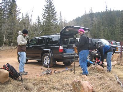 Sorting out snowshoes at The Crags trailhead, on the west side of Pikes Peak.  They needed to be carried from the start. Special thanks to Rich Page and Tom Elder for each loaning us two pairs of snowshoes.