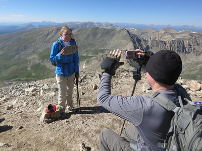 Shooting Lily with Lily's phone, capturing her FIRST 14er (without driving to the top).