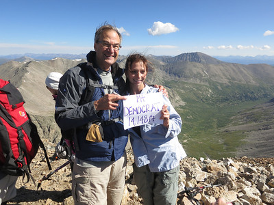 Much more than most 14ers, a lot of people carried signs with them for photos. Quandary Pk in the background on right.