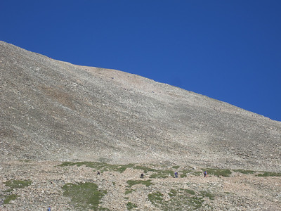 Telephoto - some climbers near the bottom and some in switchback much higher up.
