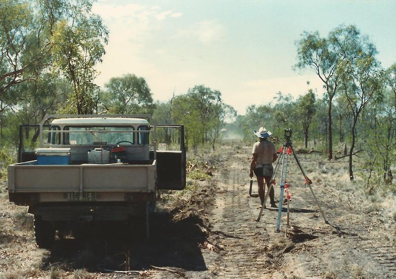 Surveying the Normanton-Karumba Water Pipeline, November 1985. Surveyor: Michael Roderick. Chainman: Vince ?