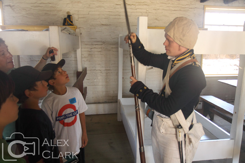 A living history actor demonstrates the use of a bayonette.