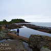 Hiking along the breakwater at the edge of Grand Marais Harbor