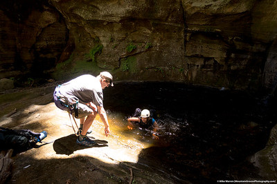 #24 - Lit perfectly by the sun, Mark helps Cherie' out of a water hole in Sundance Canyon, AZ, June