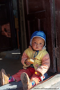 #14.  Backstory:  An infant in Jomson, Nepal, faced with the choice of eating cornbread, or a lollipop!