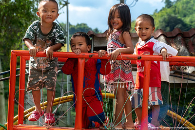#32.  Backstory:  Four kids taunting me outside of a Lahu hill tribe school in Northern Thailand.