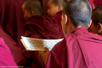 #24.  Backstory:  A novice monk reads his lines in a ceremony in Kathmandu.