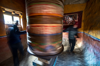 #30.  Backstory:  A long exposure catches the movement of the large prayer wheel and trekkers, on our Upper Mustang trek.