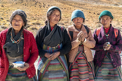 #17.  Backstory:  Chere' and I met these four ladies walking near the Nepal-Tibet border. They asked for food, but all I had was some hard candies that I had bought to hand out to the kids. When I handed one to one of the ladies, she started laughing, showing she had only 3-4 teeth in her mouth! Cherie' emptied her pack of our emergency food (a couple of bars and a small bag of peanuts), which delighted the ladies.