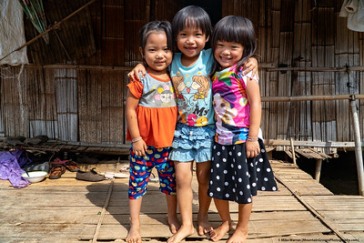 #3.  Backstory:  In October we visited a Lahu hill tribe village and school.  After playing fist bump with these cute little girls for a few minutes, they warmed up to me and posed for this super cute photo!
