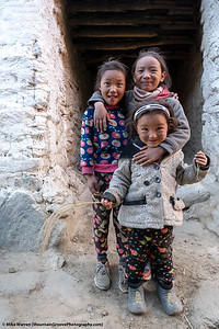 #9.  Backstory:  On our October trek through the Upper Mustang region of Nepal, I had been walking around the town of Ghami, taking pictures.  These 3 little girls spent a lot of time hiding from me.  Just when I had about given up any hope of capturing them on the camera, they ran out and posed like this for about 10 seconds, then ran as fast as they could back to their hiding spots!