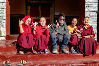 #36.  Backstory:  Our excellent guide, Simbir, of Discovery World Trekking, poses with 4 novice monks in Multinath, Nepal, on day 11 of our 12 day trek in the Upper Mustang region of Nepal.