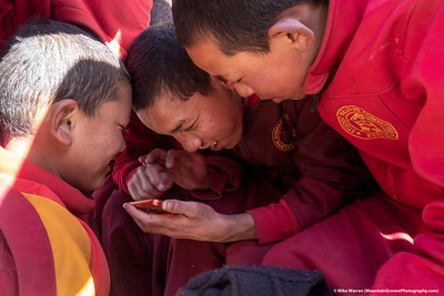 #46.  Backstory:  Novice monks play a game on a cell phone, in Lo Mathang, Nepal.