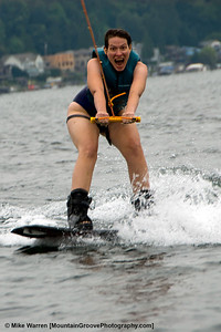 #28 - Joy on Cherie's face, as she stands up on the wakeboard on her first try, during a water skiing outing on David's boat during August.  No picture of the faceplant a couple of seconds later!!