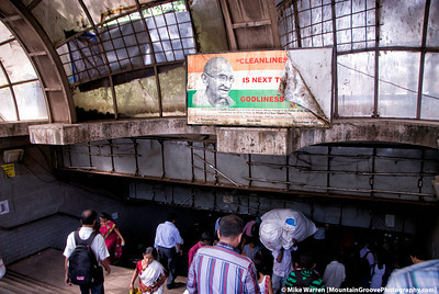 #22 - This image shows the contradictions of India, taken in Mumbai at the once ornate train station, during our trip to India in May (notice the poster above the entrance).