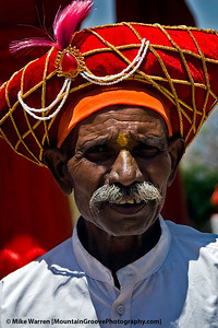 """#30 - During our May trip to India, we traveled to Sinhagad Fort, outside of Pune.  We were the only non-Indian natives amongst well over a 1,000 visitors at the time we were there.  At the Fort, we encountered this person dressed in attire belonging, I believe, to an ancient Indian general, perhaps General Tanaji Malasure.  Despite our """"guide"""" speaking no English, and we speaking no Hindu, he spent close to an hour giving us an animated tour of the ruins of the Fort.  We tipped him well, as we were much better for the experience!"""