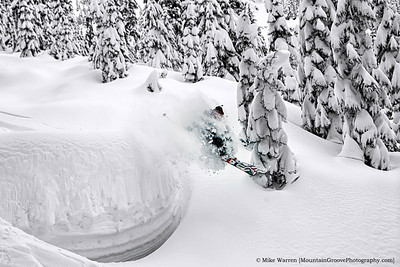#42 - Josh Hummel pulls a load of snow while taking a jump in the Alpental backcountry, during my February ski photography workshop with Jason Hummel.