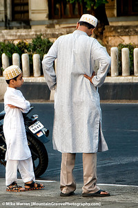 #34 - A father and son along a Mumbai, India street, taken in May.