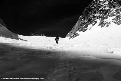 #10 - Black and white, near the Colchuck Col, on my June climb of Colchuck Pk.  Tom provides a human element to the image.