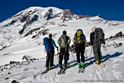 #11 - Margeaux, Chris, Radka and Han, with a spectacular view of Mt. Rainier from the Muir Snowfield, during an early January backcountry ski tour out of Paradise.