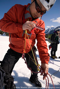 "#35 - Shengquan uses a high tech means of taking ""notes"" on how to properly set up his prusiks during snow travel practice on the Hyak ""glacier"" in April."