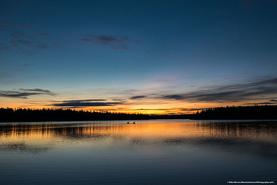 #25 - Two kayakers paddle into the sunset.  Chena Lakes, AK, September
