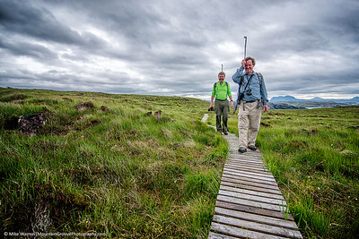 Tom and Angus, Nanda Island, Scotland, in June.  The sticks were to ward off diving birds [protecting their territory!