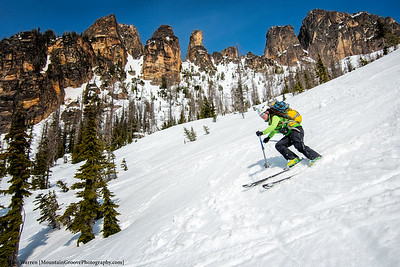 Bri skis the North Cascades backcountry, with the Liberty Bell massif in the background, in May.