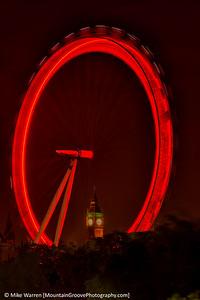 The Eye of London frames Big Ben, London, in July.