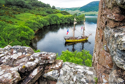 An old period ship, as seen from Urquhart Lake, Loch Ness, Scotland, in June.