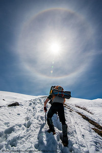 Halo over climber, Mt. Baker, in June.