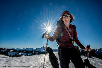 #10 - During a December ski tour above Paradise, I saw Cherie' approaching with the sun behind her.  I stopped down the aperture for the sun star, got low, and was lucky when the sun star appeared to be the end of the ski pole.  Handheld, f/16, 1/200, ISO100