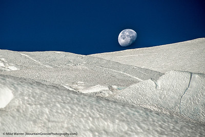 #5 - Moonset on Mt. Rainier.  This image was taken at about 12,000' during my July climb of Mt. Rainier, with a telephoto lens (Nikon 28-300) to compress the crevasses in the foreground, and setting moon.  Handheld, f/8.0, 1/1250, ISO200