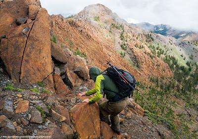 #31 - June, Bill descending ridge, Bean Peak in background