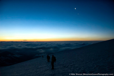 High on the glacier, clouds below up, waiting for sunrise