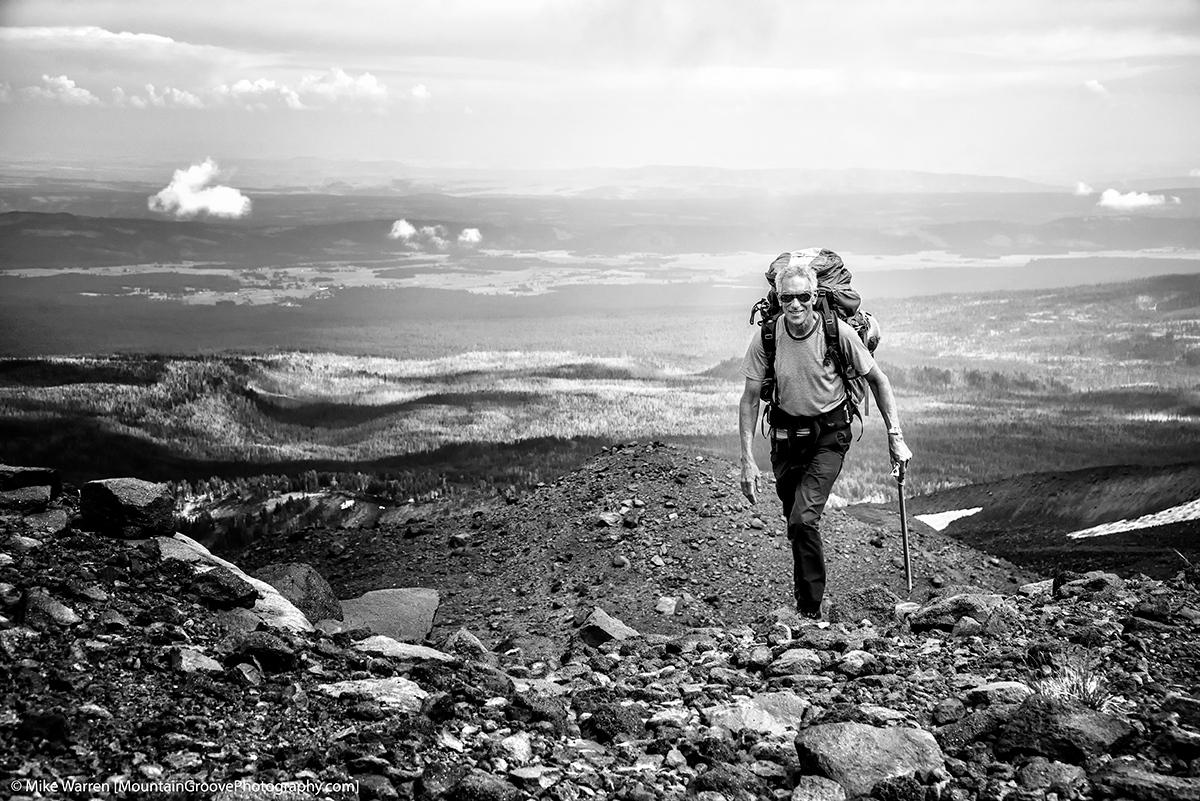 John, cresting the ridge to basecamp