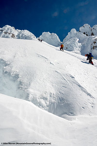 Steep upper mountain, with the  bergschrund ready to swallow any climber that may slip.