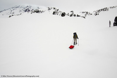Rich in a sea of white, pulling his sled and training for Denali.